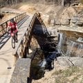 Kelly Williams, director of the FAST National Mountain Bike Patrol, crosses a creek along the Back 4...