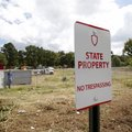 Property near 19th Street and College Avenue in Fayetteville is being cleared Thursday by the Univer...
