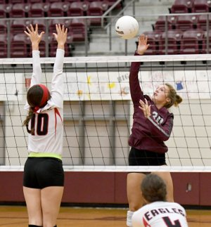 Bud Sullins/Special to Siloam Sunday Siloam Springs senior Katie Kendrick hits over Vilonia's Lainey Wilson during Thursday's match at Panther Activity Center.
