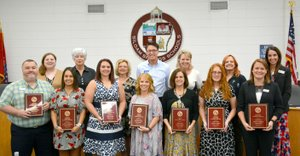 Janelle Jessen/Siloam Sunday Teachers of the year were recognized during Thursday's school board meeting. Pictured, from left, are Doug Hartman, Middle School teacher of the year; Aimee Morrell, representative of Middle School Adopters; Umia Fullerton, Northside Elementary School teacher of the year; Debi Selby, Northside Elementary School Adopters representative; Keli Sumter, Intermediate School teacher of the year; Nena Houston, Intermediate School Adopters representative; Amanda Ward, Allen Elementary School teacher of the year; Bobby Reed, Allen Elementary School Adopters representative; Lanna Hardy, Main Street Academy teacher of the year; State Rep. Robin Lundstrum (R-District 87), Main Street Academy Adopters representative; Alishia Morris, Southside Elementary School teacher of the year; Patti Eiland, Southside Elementary School Adopters representative; Megan Denison, Siloam Springs High School teacher of the year; and Anne Martfeld, SSHS principal. Jake Wilmont, SSHS Adopters representative is not pictured.