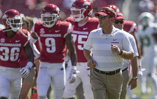 Arkansas coach Chad Morris runs onto the field during warmups prior to a game against North Texas on Saturday, Sept. 15, 2018, in Fayetteville.