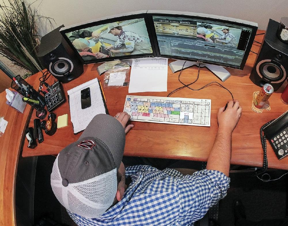 Michael Middleton of JM Associates edits video of a Bassmaster fishing tournament in August.