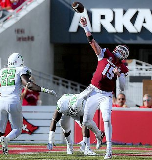 NWA Democrat-Gazette/Charlie Kaijo ILL-ADVISED: Arkansas quarterback Cole Kelley (15) heaves a pass downfield Saturday during the second quarter of the Razorbacks' 44-17 home loss to North Texas at Donald W. Reynolds Razorback Stadium in Fayetteville.