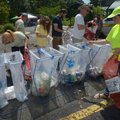Volunteers sort recyclables Saturday, July 8, 2017, at the Hobbs State Park - Conservation Area visi...
