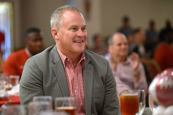 Hunter Yurachek, director of athletics at the University of Arkansas, laughs Friday, Aug. 17, 2018, during the annual Kickoff Luncheon at the Northwest Arkansas Convention Center in Springdale.