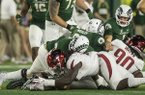 Arkansas defensive lineman McTelvin Agim recovers a fumble during a game against Colorado State on Saturday, Sept. 8, 2018, in Fort Collins, Colo.
