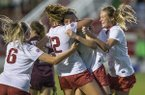 Carly Hoke (from left), Kayla McKeon, Tori Cannata and Stefani Doyle of Arkansas celebrate after a goal by Cannata in the second half of a match against Texas A&M on Thursday, Sept. 20, 2018, at Razorback Field in Fayetteville.