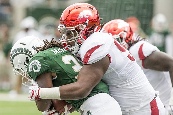 Arkansas defensive lineman Armon Watts (90) tackles Colorado State running back Marcus McElroy during a game Saturday, Sept. 8, 2018, in Fort Collins, Colo.