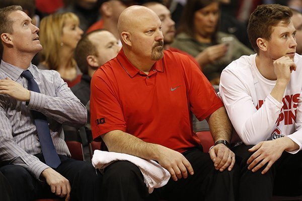 Dave Richardson (center) spent 12 seasons as the basketball strength coach at Ohio State from 2005-17.