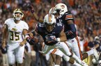Auburn running back Devan Barrett (10) dives into the end zone for touchdown after a blocked punt by Alabama State during the first half of an NCAA college football game, Saturday, Sept. 8, 2018, in Auburn, Ala. (AP Photo/Vasha Hunt)