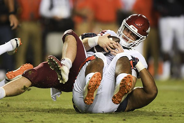 Arkansas quarterback Ty Storey is sacked during a game against Auburn on Saturday, Sept. 22, 2018, in Auburn, Ala.