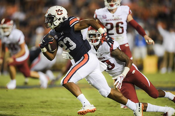 Auburn receiver Ryan Davis returns a punt during the fourth quarter of a game against Arkansas on Saturday, Sept. 22, 2018, in Auburn, Ala.