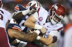 Arkansas quarterback Ty Storey falls forward during a game against Auburn on Saturday, Sept. 22, 2018, in Auburn, Ala.