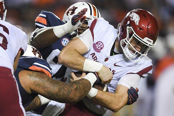 Arkansas quarterback Ty Storey falls forward during a game against Auburn on Saturday, Sept. 22, 2018, in Auburn, Ala.