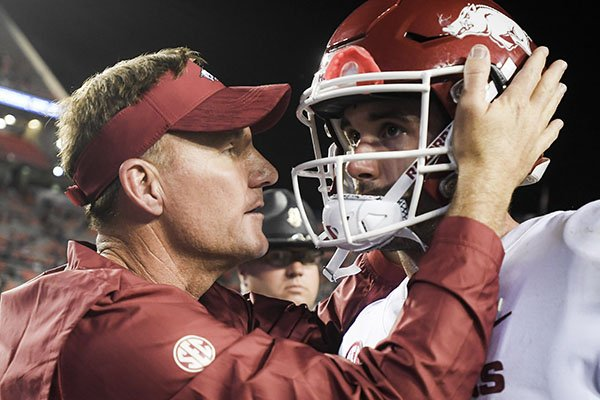 Arkansas coach Chad Morris (left) talks with quarterback Ty Storey following a game against Auburn on Saturday, Sept. 22, 2018, in Auburn, Ala. The Razorbacks lost to the Tigers, 34-3.