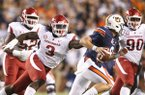 Arkansas defensive lineman McTelvin Agim (3) chases Auburn quarterback Jarrett Stidham during a game Saturday, Sept. 22, 2018, in Auburn, Ala.