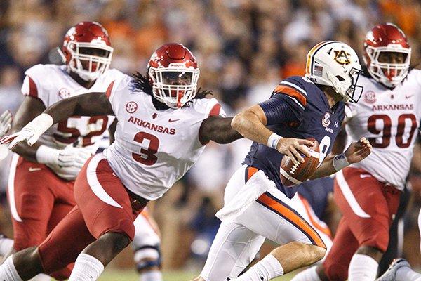 Arkansas defensive lineman McTelvin Agim (3) chases Auburn quarterback Jarrett Stidham during a game Saturday, Sept. 22, 2018, in Auburn, Ala.
