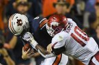 Arkansas Razorbacks defensive lineman Randy Ramsey (10) grabs onto the facemask of Auburn Tigers quarterback Jarrett Stidham (8) during the second quarter of a football game, Saturday, September 22, 2018 at Jordan-Hare Stadium in Auburn. The penalty resulted in a first down and a touchdown
