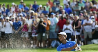 Tiger Woods hits ...