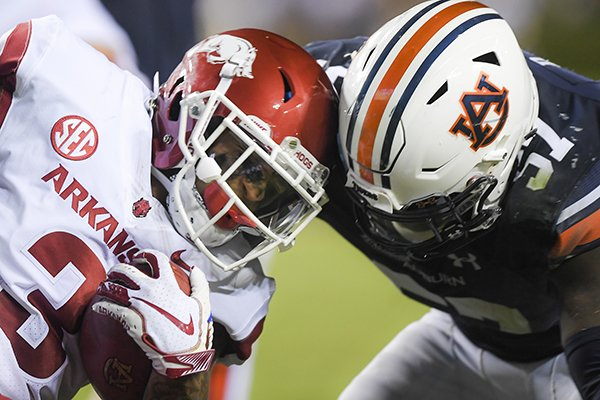 Arkansas receiver Deon Stewart (3) collides with Auburn linebacker Deshaun Davis (57) during a game Saturday, Sept. 22, 2018, in Auburn, Ala.