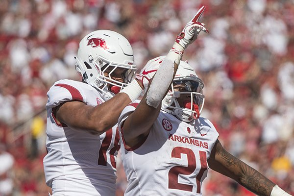Jeremy Patton, Arkansas tight end, congratulates Devwah Whaley (21), Arkansas running back, after Whaley scored a touchdown in the second quarter vs Eastern Illinois Saturday, Sept. 1, 2018, at Razorback Stadium in Fayetteville.