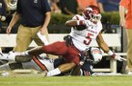 Arkansas running back Rakeem Boyd (5) is tackled by an Auburn defender during a game Saturday, Sept. 22, 2018, in Auburn, Ala.