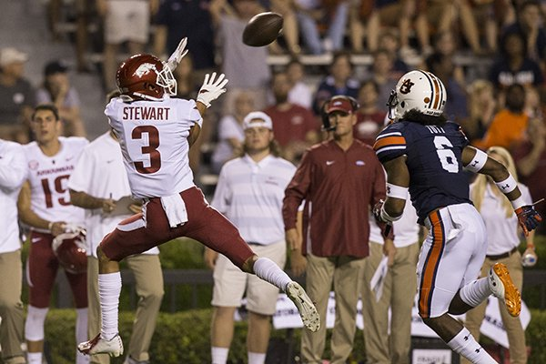 Arkansas receiver Deon Stewart catches a pass from quarterback Ty Storey in the first quarter of the Razorbacks' 34-3 loss at Auburn on Sept. 22, 2018 in Jordan-Hare Stadium.