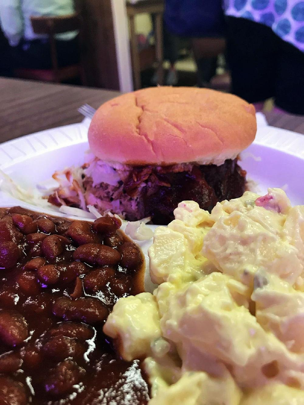 The Pulled Pork Sandwich Plate has beans and potato salad on the side.