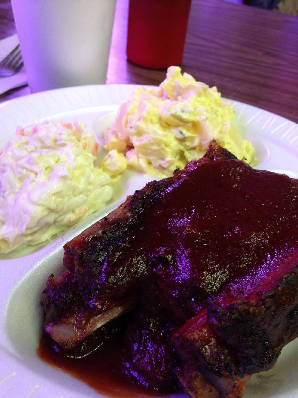 Ribs come slathered in H.B.'s tangy sauce.