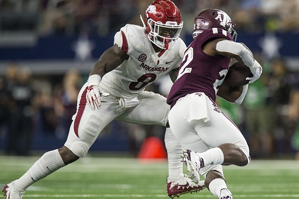 Arkansas linebacker De'Jon Harris prepares to tackle Texas A&M running back Kwame Etwi during a game Saturday, Sept. 29, 2018, in Arlington, Texas.