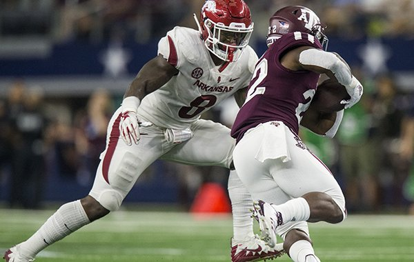 Arkansas linebacker De'Jon Harris prepares to tackle Texas A&M running back Kwame Etwi during a game Saturday, Sept. 29, 2018, in Arlington, Texas.