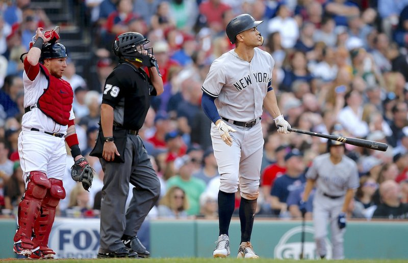 d4a4f392c3 New York Yankees' Giancarlo Stanton, right, watches his solo home run in  front of Boston Red Sox's Christian Vazquez, left, during the seventh  inning of a ...