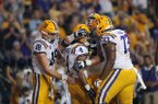 LSU running back Nick Brossette (4) is congratulated by teammates after his touchdown carry in the first half of an NCAA college football game against Mississippi in Baton Rouge, La., Saturday, Sept. 29, 2018. (AP Photo/Gerald Herbert)