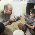 Rick Spicer owner of Pack Rat Outdoor Center, creates a fire as Brooks Ferguson looks on during a Bu...