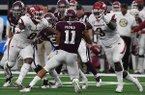 Arkansas' De'Jon Harris (8) and McTelvin Agim sack Texas A&M's quarterback Kellen Mond on Saturday Sept. 29, 2018, at AT&T Stadium in Arlington, Texas. The Aggies beat the Razorbacks 24-17.