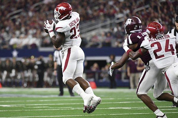 Arkansas linebacker Dre Greenlaw (23) intercepts a pass from Texas A&M quarterback Kellen Mond during the second quarter of an NCAA college football game, Saturday, Sept. 29, 2018, in Arlington, Texas. (AP Photo/Jeffrey McWhorter)