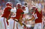 Alabama wide receiver Derek Kief (81) celebrates with teammates after blocking a punt against Louisiana-Lafayette during the first half of an NCAA college football game, Saturday, Sept. 29, 2018, in Tuscaloosa, Ala. (AP Photo/Butch Dill)