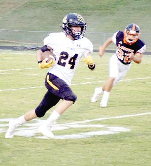 RANDY MOLL NWA NEWSPAPERS Prairie Grove senior Jacob Watson took a lateral from Jackson Sorters and returned the opening kickoff 87 yards for a touchdown to begin the Tigers' 42-0 rout of Gravette Friday. Prairie Grove had three scoring plays of better than 85 yards during the contest.