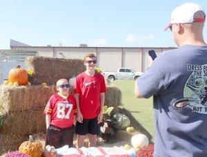 LYNN KUTTER ENTERPRISE-LEADER Doug Chambers of Farmington snaps a photo of his sons Blaine Chambers, 13, and Brett Chambers, 7, at the Farmington Fall Festival.