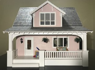 This 2018 photo provided by Amy Dorman shows the beach bungalow dollhouse she created in Des Moines, Iowa. The art of dollhouse design has gotten big thanks to social media. Fans can share pictures of their miniature creations and draw inspiration from each other. And today's creations tend to feature a modern look. (Amy Dorman via AP)