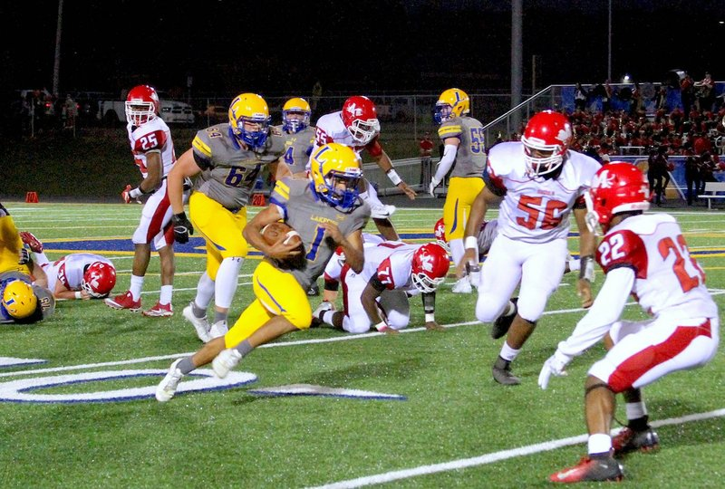 2f68e975883 The Sentinel-Record Jami Smith LEADING RUSHER  Lakeside sophomore running  back Isaac Echols attacks the Magnolia defense Friday at Chick Austin Field  during ...