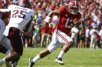 Alabama quarterback Tua Tagovailoa (13) scrambles for a first down against Texas A&M during the first half of an NCAA college football game, Saturday, Sept. 22, 2018, in Tuscaloosa, Ala. (AP Photo/Butch Dill)
