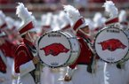 Arkansas marching band members stand on the field prior to a game against North Texas on Saturday, Sept. 15, 2018, in Fayetteville.