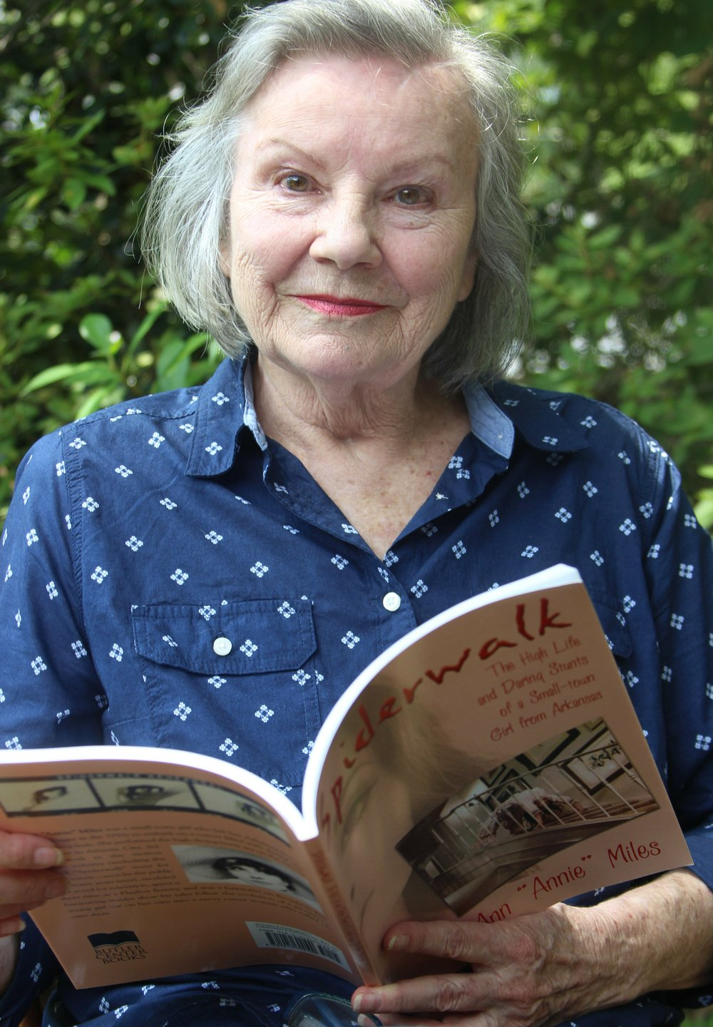 "Ann Miles poses with her book ""Spiderwalk"" at her home in Pine Bluff.  (Special to the Democrat-Gazette/DEBORAH HORN)"
