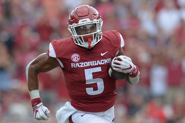Arkansas running back Rakeem Boyd carries the ball against Alabama Saturday, Oct. 6, 2018, during the second quarter at Razorback Stadium in Fayetteville. Visit nwadg.com/photos to see more photographs from the game.