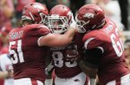 Arkansas tight end C.J. O'Grady (85) is congratulated by teammates after catching a touchdown pass during a game against Alabama on Saturday, Oct. 6, 2018, in Fayetteville.