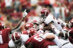 Alabama running back Damien Harris (34) runs for a touchdown during a game against Arkansas on Saturday, Oct. 6, 2018, in Fayetteville.