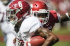 Arkansas linebacker Dre Greenlaw chases Alabama receiver DeVonta Smith during a game Saturday, Oct. 6, 2018, in Fayetteville.