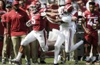 Arkansas running back Rakeem Boyd stiff arms Alabama defensive back Saivion Smith during a game Saturday, Oct. 6, 2018, in Fayetteville.