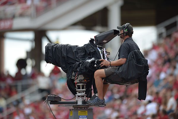 An ESPN camera operator shoots a game between Arkansas and Alabama on Saturday, Oct. 6, 2018, in Fayetteville.